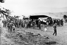People surround Amelia Earhart's single-engine Lockheed Vega plane after she landed in an open field near Londonderry, northern Ireland, on May 21, 1932.  Earhart began her solo nonstop transatlantic flight on May 20 from Newfoundland, Canada.  (AP Photo)