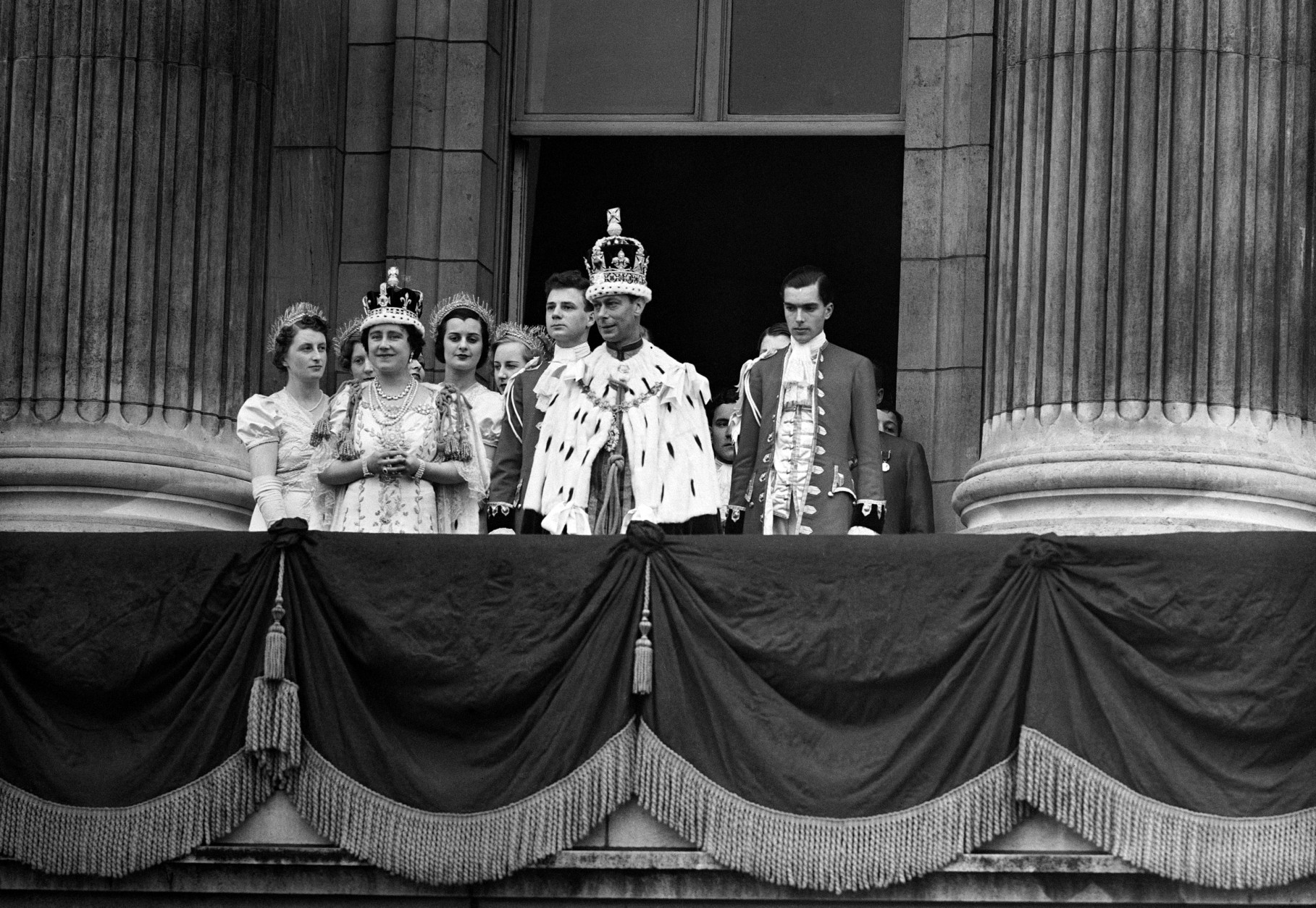King George VI and Queen Elizabeth on the balcony of Buckingham Palace, in London, on their return from Westminster Abbey, on May 12, 1937, following their Coronation service. (AP Photo)