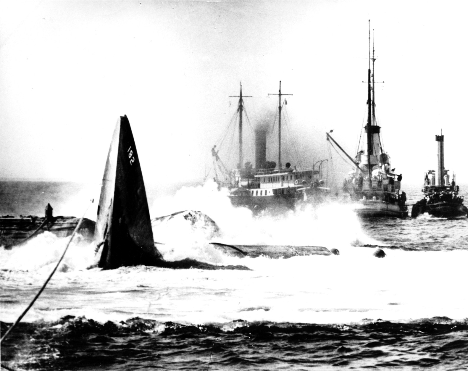 This is a photo of the submarine USS Squalus as it breaks through the surface of the Atlantic ocean off the coast of Portsmouth, N.H., during a failed salvaged attempt on May 28, 1939.  (AP Photo)