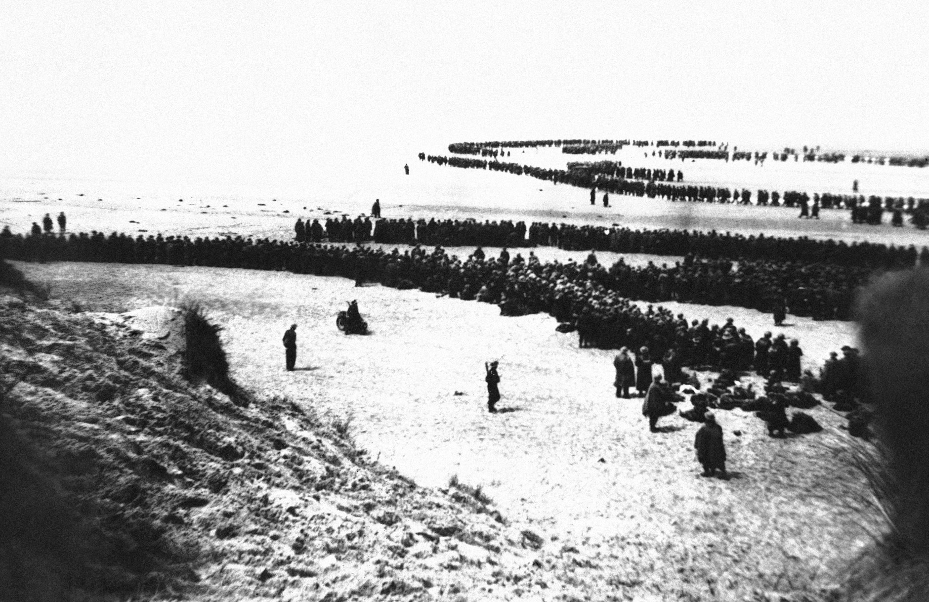 Thousands of British and French troops massed on the beach of Channel port in Dunkirk, France on June 4, 1940 awaiting ships to return them to England. British reports estimated 335,000 allied troops were evacuated from the German held pocket in Flanders in what was described as the greatest retreat in military history. (AP Photo)