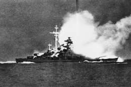 A direct hit blasts the 5,000-ton German battleship Bismarck shortly before it sank in the Atlantic 400 miles West of Brest, France, following a 1,750 mile chase from Bergen, Norway, by air and sea units of the British Navy. This picture, which has just become available, was taken by Yeoman 1/c Fritz Dungert aboard the former German Cruiser Prinz Eugen which is now at Philadelphia prepared  to sail to the South Pacific where it will be one of the targets in the atomic bomb tests next May. Dungert says the picture was taken May 27, 1941, the day the Bismarck went down. (AP Photo)
