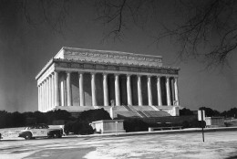 The Lincoln Memorial is admittedly one of the finest memorials of modern times in Washington on Jan. 8, 1942. The exterior of the memorial building symbolizes the Union of the States. Thirty-six columns of Indiana limestone form a colonnade representing the 36 states which existed at the time of Lincoln's death, the frieze above it bearing the names of the 48 States of the Union as they exist. Inside is a sanctuary containing a colossal marble statue of the Emancipator. On the north wall is inscribed Lincoln's Second Inaugural address and on the south wall, the famous Gettysburg Speech. The Memorial was designed by Henry Bacon, architect and the statue by Daniel Chester French, sculptor. The memorial was visited by 1,758,810 persons during 1941, 362,995 visiting the memorial in April, the busiest month. (AP Photo)