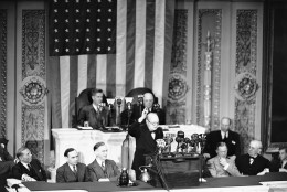 "Prime Minister Winston Churchill in the House of Representatives in Washington on May 19, 1943. Churchill pledged Congress that Britain would stick with the U.S. in a campaign to pulverize Japan, asserted ""we shall make out enemies in Europe and in Asia burn and consume their strength on land, on sea and in the air."" (AP Photo)"