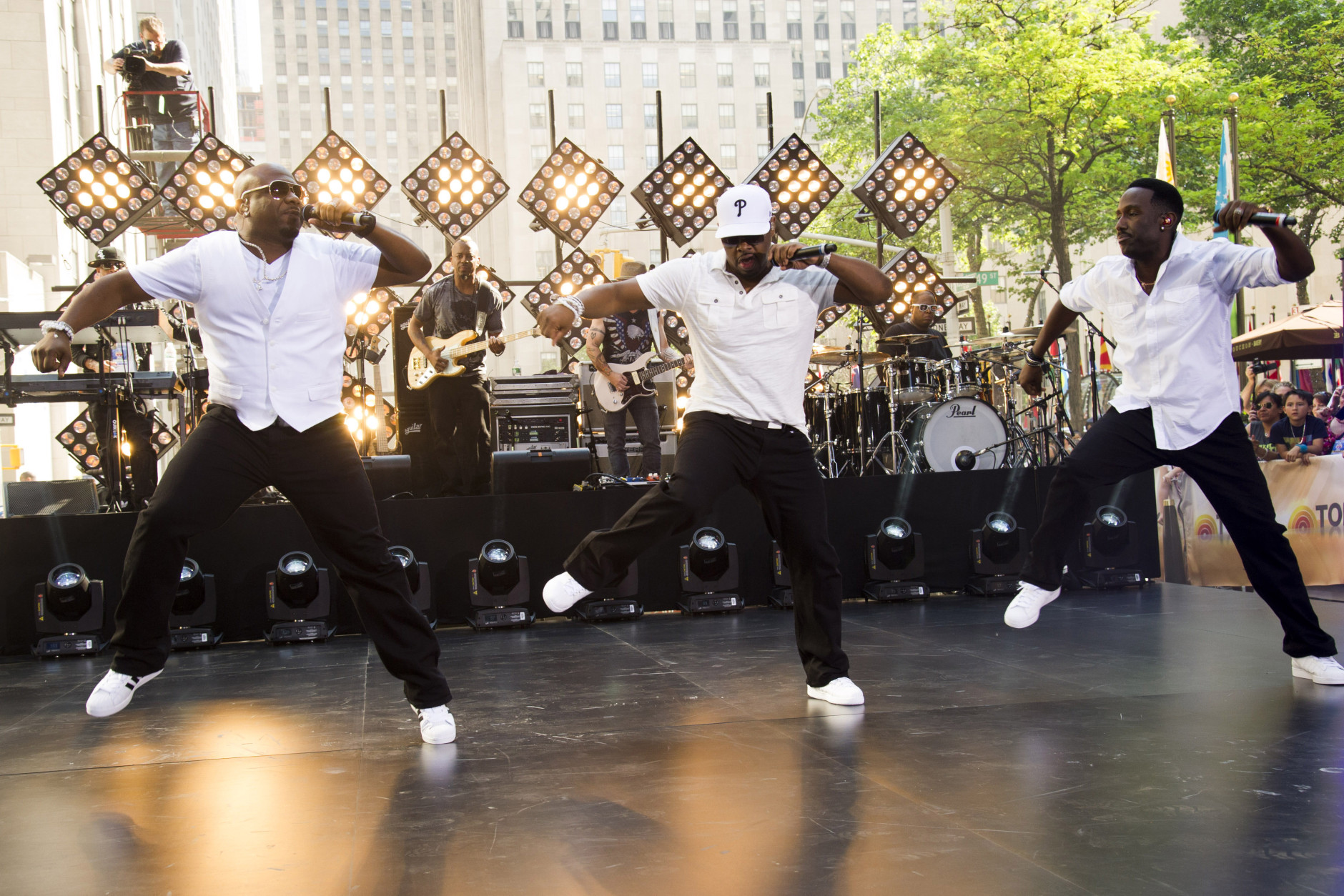 """Boyz II Men band members, from left, Wanya Morris, Nathan Morris and Shawn Stockman perform on NBC's """"Today"""" show on Friday, May 31, 2013 in New York. (Photo by Charles Sykes/Invision/AP)"""