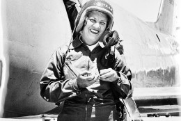 Jacqueline Cochran stands in front of the Canadian-built F-86 Sabre jet, in which she became the first woman to break the sound barrier, at Edwards Air Force Base, Ca., May 19, 1953. Cochran made history on May 18, flying at a speed of 625.5 miles per hour.  (AP Photo)