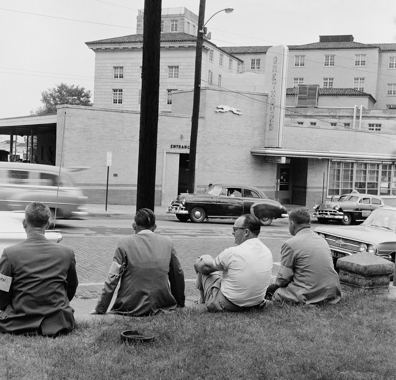 Federal marshals, wearing bright yellow arm bands, keep an eye on the bus station after a band of freedom riders were beaten by a mob when they arrived from Birmingham the previous day, May 21, 1961, Montgomery, Ala. (AP Photo/Horace Cort)