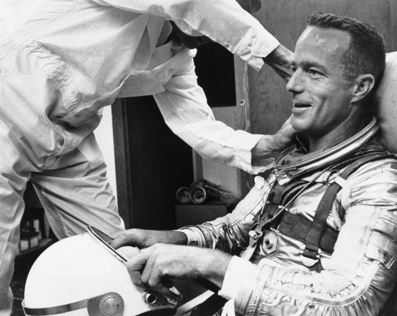 Astronaut Scott Carpenter gets a final going over from a suit technician as he prepares for orbital flight at Cape Canaveral, Florida, May 24, 1962. (AP Photo)