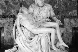 General view of famed Pieta sculpture, created by Michelangelo, shown, Dec.12, 1962, Saint Peters Basilica, Rome, Italy. The statue depicts Mary with the dead Christ lying across her knee, was made by Michelangelo when he was only 25 years old. It is slated to be shipped to America for the 1964 World's Fair, at the request of Francis Cardinal Spellman, Archbishop of New York, to which Pope John XXIII agreed. (AP Photo/Mario Torrisi)