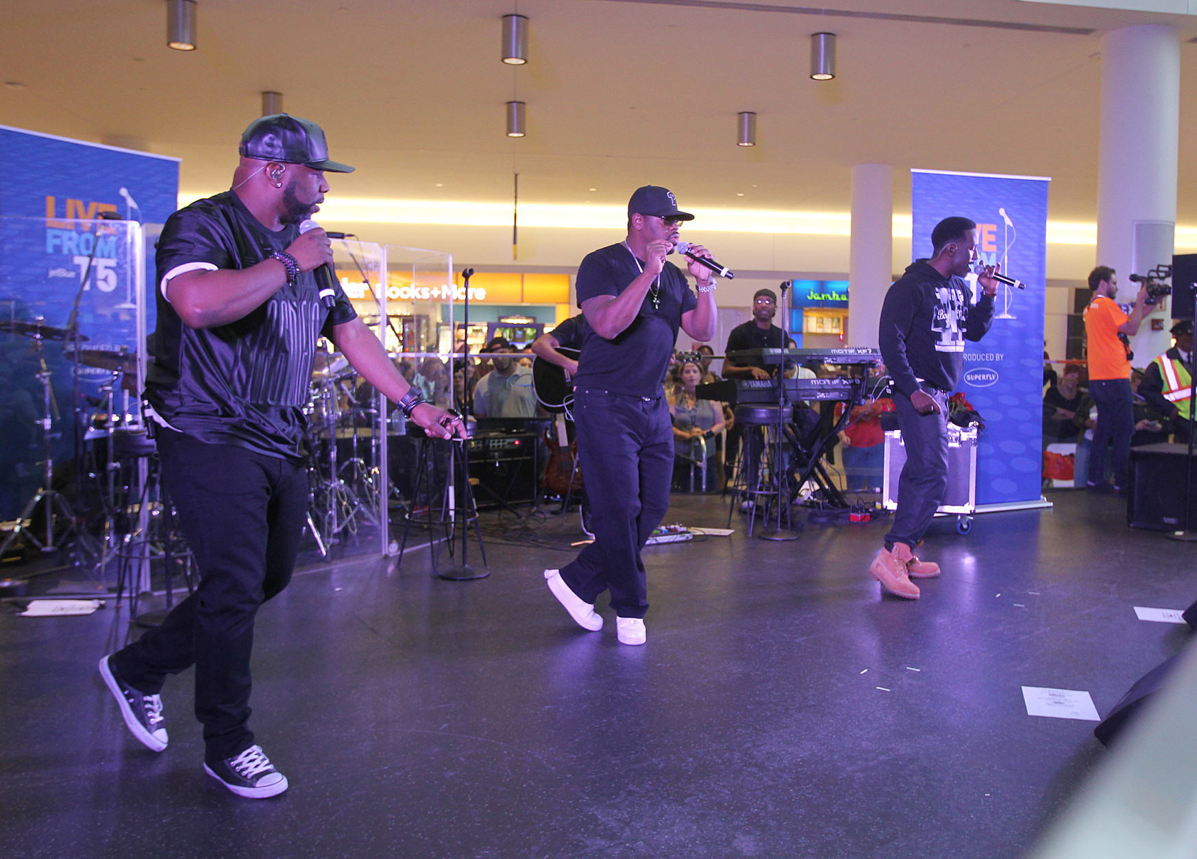 Wanya Morris left, Nathan Morris and Shawn Stockman of Boyz II Men perform at JetBlue's Live From T5 at JFK Airport on Thursday, Sept. 24, 2015, in New York. (Photo by Donald Traill/Invision/AP)