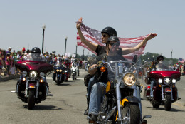 Participants in the Rolling Thunder annual motorcycle rally ride past Arlington memorial bridge during the parade ahead of Memorial Day in Washington, Sunday, May 24, 2015.  (AP Photo/Jose Luis Magana)