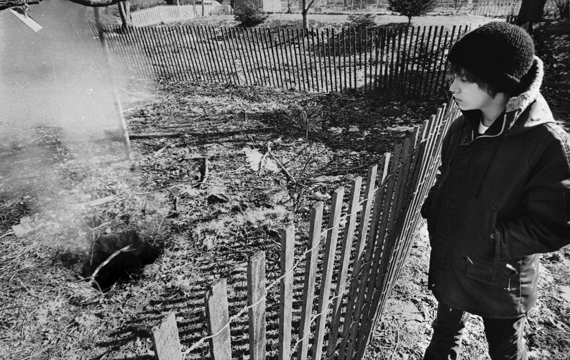 Twelve year old Todd Domboski of Centralia, Pennsylvania, looks over a police barricade at the hole he fell through just hours before photo was taken on Feb. 14, 1981 in Centralia. The hole was caused by a mine fire that?s been burning since 1962. (AP Photo)
