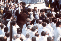 """In this May 12, 1982 file photo Pope John Paul II is seen on his popemobile after he celebrated a mass in Fatima Square, Portugal, May 12, 1982.  The longtime private secretary of the late Pope John Paul II has revealed that the pope was wounded in a 1982 knife attack by a priest in Portugal. Cardinal Stanislaw Dziwisz makes the revelation in """"Testimony,'' a movie on John Paul's life that was screened for Pope Benedict XVI at the Vatican on Thursday, Oct. 16, 2008.  It was known that John Paul was assaulted by a knife-wielding Spanish priest while visiting the shrine of Fatima in Portugal to give thanks for surviving an assassination attempt in 1981, when he was shot by a Turkish gunman in St. Peter's Square. (AP Photo)"""