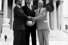 """FILE - This May 17, 1954 file photo shows, from left, George E.C. Hayes, Thurgood Marshall, and James M. Nabrit joining hands as they pose outside the Supreme Court in Washington.  The three lawyers led the fight for abolition of segregation in public schools before the Supreme Court, which ruled today that segregation is unconstitutional. On May 17, 1954, a hushed crowd of spectators packed the Supreme Court, awaiting word on Brown v. Board of Education, a combination of five lawsuits brought by the NAACP's legal arm to challenge racial segregation in public schools. The high court decided unanimously that """"separate but equal"""" education denied black children their constitutional right to equal protection under the law, effectively removing a cornerstone that propped up Jim Crow, or state-sanctioned segregation of the races. (AP Photo, File)"""