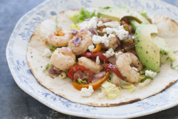 This Mar. 17, 2014 photo shows a sweet and tangy shrimp taco in Concord, N.H. (AP Photo/Matthew Mead)