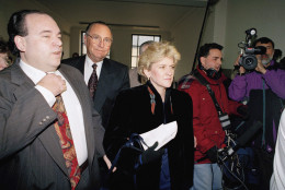 """Mary Joe Buttafuoco arrives carrying her notes on December 1, 1992 at court in Mineola, New York, followed by her attorney Michael Rindenow, left, for the sentencing of Amy Fisher, the Long Island teen who tried to kill her. This is the first time since the May shooting that Buttafuoco has become face-to-face with her assailant, Fisher was sentenced to a five-to-15-year term in the """"Teen Attraction"""" love triangle shooting. (AP Photo/Richard Drew)"""