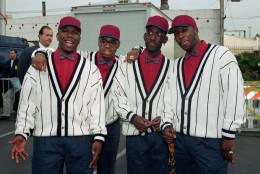 Boyz II Men members, from left, Wanya Morris, Nathan Vanderpool, Shawn Stockman and Mike McCary pose at the American Music Awards in Los Angeles, Calif., on Jan. 25, 1993.  (AP Photo/Julie Markes)