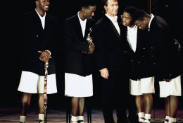 Members of the rock group, Boyz II Men, of Philadelphia, receive their trophy from movie star Patrick Swayze, center, during the World Music Awards in Monte Carlo on May 12, 1993. Boyz II Men's award was for the best new group of the year. (AP Photo/Gilbert Tourte)