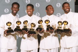 """Boyz II Men, shown in this March 1, 1995  photo, display their Grammy awards for Best R&B Album and for Best R&B Duo or Vocal Performance. From left are Shawn Stockman, Nate Morris, Wanya Morris and Michael S. McCary.  Along with Mariah Carey the group was nominated Thursday, Jan. 4, 1996, for a Grammy for  """"One Sweet Day"""" as the record of the year.  Winners will be announced Feb. 27. (AP Photo/Mark J. Terrill)"""