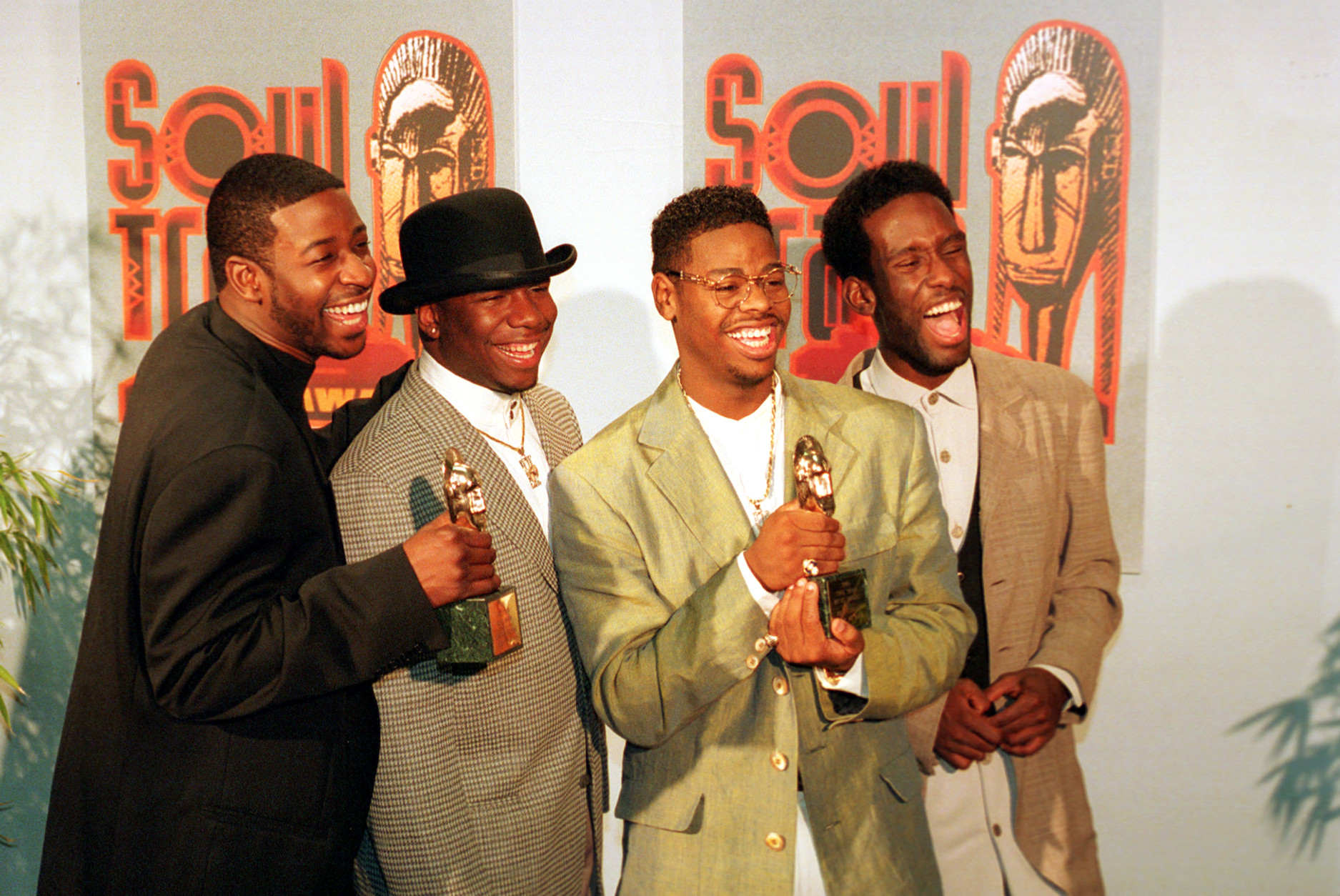 The group Boyz II Men display their two awards backstage at the Soul Train Music Awards in Los Angeles, Ca., Monday, March 13, 1995.  The group won for best rhythm and blues single, group, band or duo; and for best rhythm and blues album, group.  The members, from left, are, Michael McCary, Wanya Morris, Nate Morris and Shawn Stockman.  (AP Photo/Eric Draper)