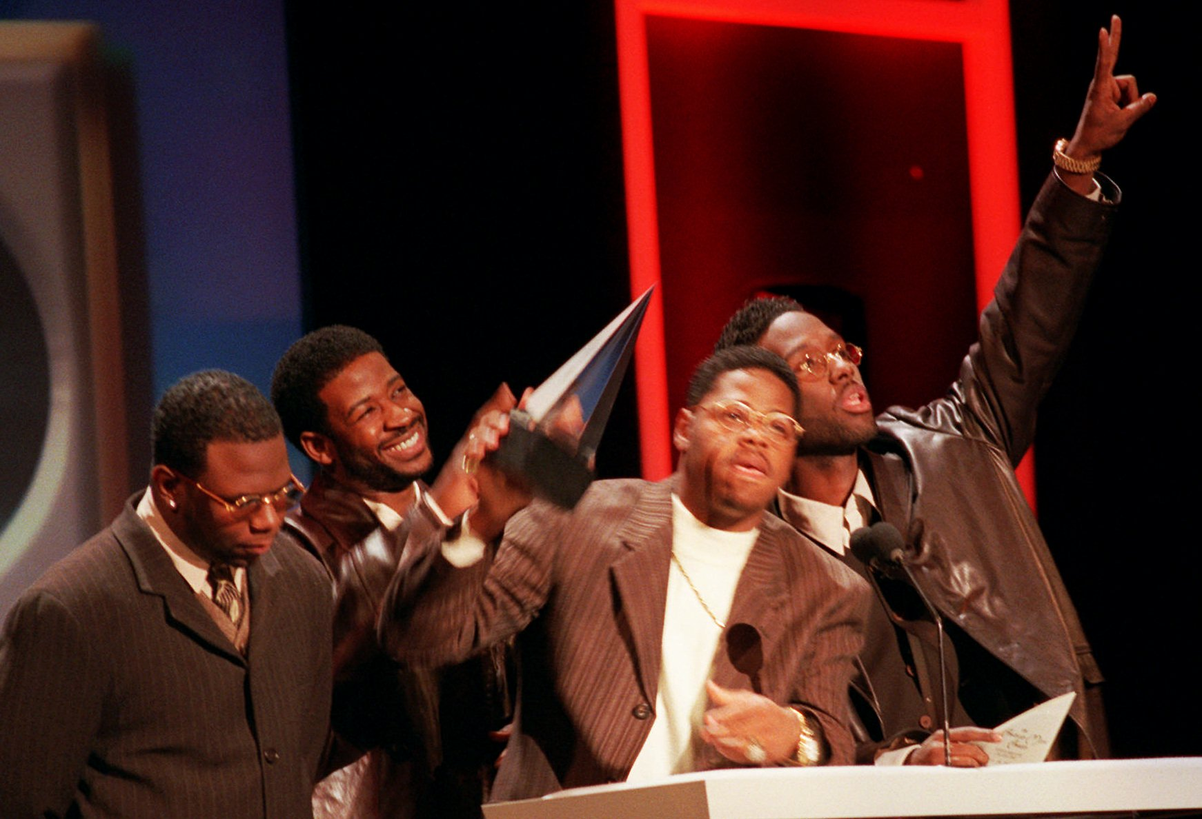 Boyz II Men, left to right, Wanya Morris, Nate Morris, Michael McCary, and Shawn Stockman show off their award for Best Soul Album at the 23rd Annual American Music Awards at the Shrine Auditorium in Los Angeles Monday, Jan. 29, 1996. (AP Photo/Kevork Djansezian)