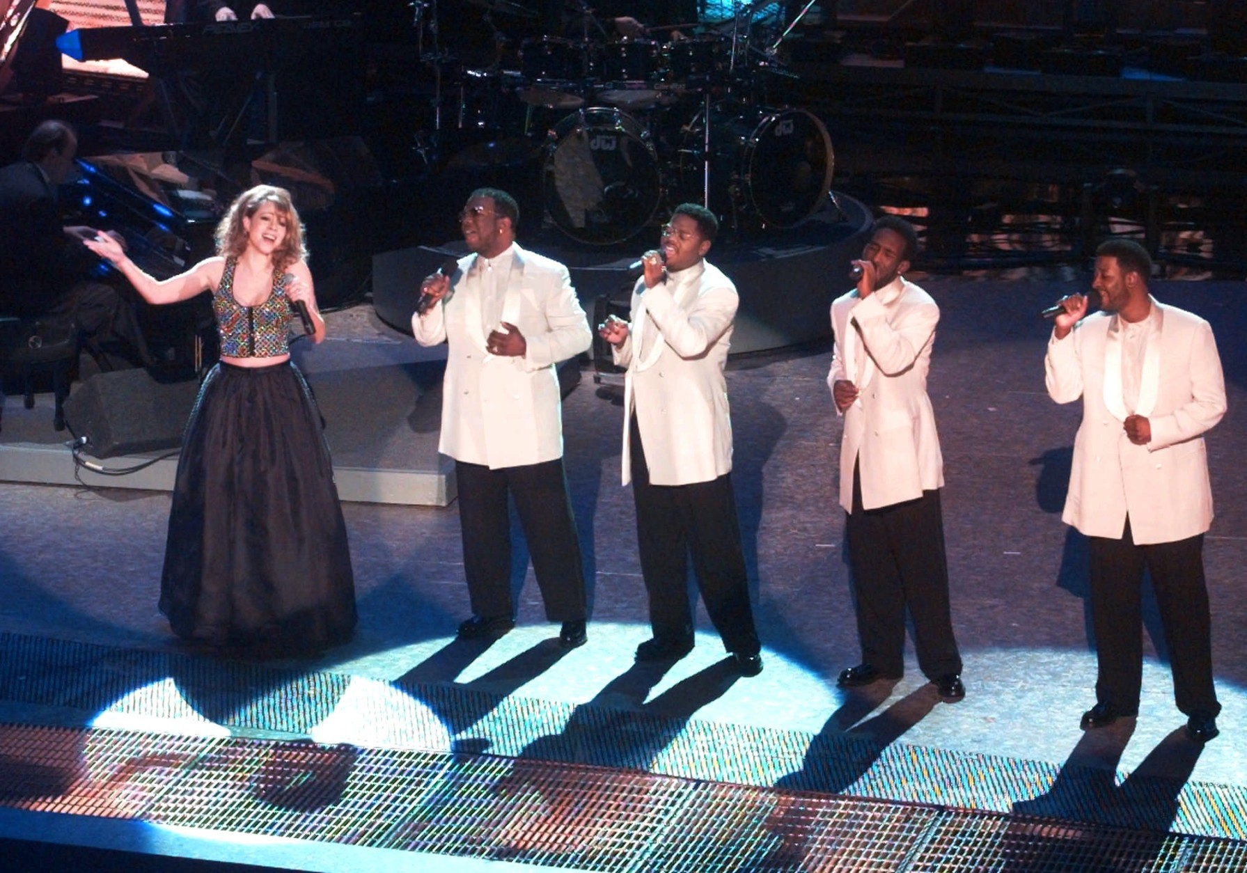 Mariah Carey performs with Boyz II Men during the opening of the 38th annual Grammy Awards at the Shrine Auditorium in Los Angeles Wednesday, Feb. 28, 1996. Boyz II Men members are, from right, Nate Morris, Shawn Stockman, Michael McCary and Wanya Morris. (AP Photo/Eric Draper)