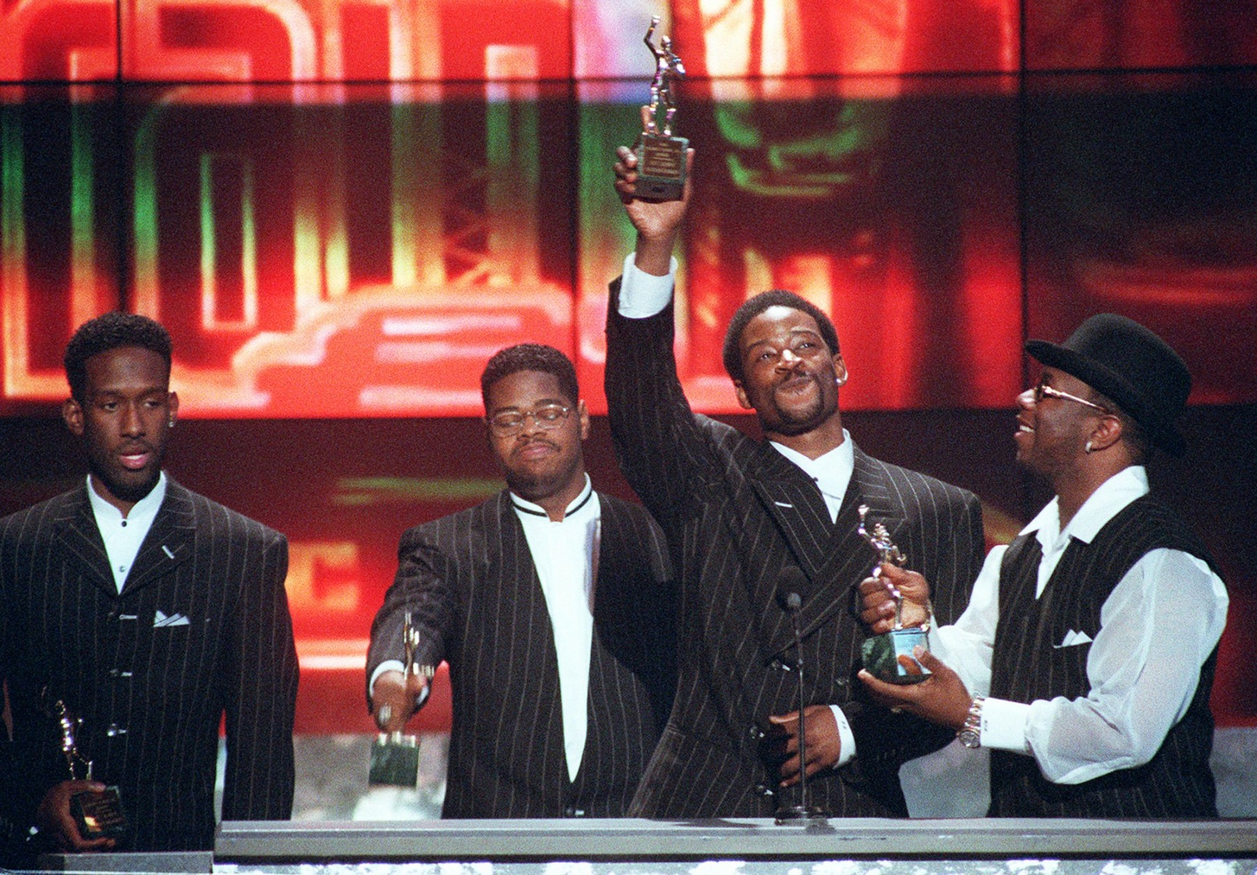Members of the group Boyz II Men, from left, Shawn Stockman, Michael McCary, Nate Morris and Wanya Morris accept the Sammy Davis Jr. award for Entertainers of the Year at the Soul Train Awards at the Shrine Auditorium in Los Angeles, Friday, March 29, 1996. (AP Photo/Mark J. Terrill)