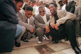 Boyz II Men members from left, Michael McCary, Nathan Morris, Wanya Morris, and Shawn Stockman, pose with their commemorative plaque in Philadelphia, Thursday, May 9, 1996. The group and other musical artists were honored at the Philadelphia Music Hall of Fame Awards. (AP Photo/Mpozi Mshale Tolbert)