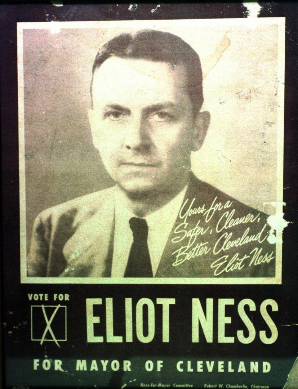 A framed poster from Eliot Ness's unsuccessful run for  mayor of Cleveland in 1947 hangs in the Cleveland Police Historical Society at Cleveland police headquarters on Wednesday, June 25, 1997. The cremated remains of Ness will be dispersed in a Cleveland cemetery on Sept. 10. (AP Photo/Piet van Lier)