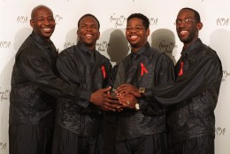 Members of Boyz II Men are shown after winning the award for Best Soul/Rhythm and Blues Group at the 25th annual American Music Awards at the Shrine Auditorium in Los Angeles, Monday, Jan. 26, 1998.  The band members are Michael McCary, Nathan Morris, Wanya Morris and Shawn Stockman. (AP Photo/Michael Caulfield)