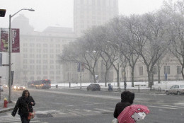 The Travelers tower is partially obscured by falling snow on Main Street in Hartford, Conn., on Friday, Feb. 5, 2016. The storm slowed the morning commute, prompted school closings and forced flight cancellations and delays. (AP Photo/Dave Collins)