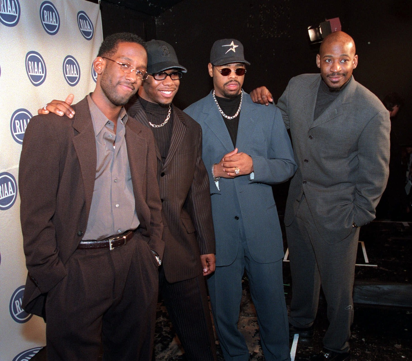 """Members of the group """"Boyz II Men,"""" from left, Shawn Stockman, Wanye Morris, Nate Morris, and Michael McCary, pose for the media after receiving their """"Diamond Award"""" from the Recording Industry Association of America, in New York Tuesday, March 16, 1999. RIAA has created the award to recognize performers who have sold 10 million units of a single title in the United States. (AP Photo/Stuart Ramson)"""