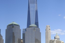 Sailboats pass One World Trade Center, tallest, during Race 3 of the America's Cup World Series sailing event in New York, Sunday, May 8, 2016. Emirates Team New Zealand won the N.Y. event. (AP Photo/Seth Wenig)