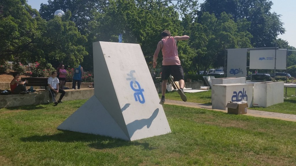 """A parkour athlete jumps off an obstacle at the """"Beast Coast"""" parkour festival in Rosslyn, Va., on Saturday. The festival is one of the largest in the world, said Mark Toorock, founder of D.C.-based American Parkour. (WTOP/Kathy Stewart)"""