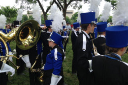 Cedaredge High School's marching band warms up for the National Memorial Day Parade on Monday. (WTOP/Megan Cloherty)