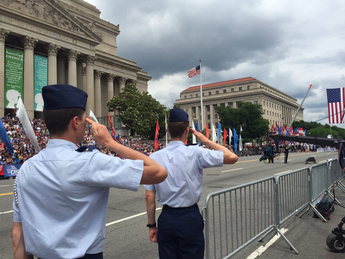 The National Anthem is performed ahead of the National Memorial Day Parade on Monday. (WTOP/Megan Cloherty)