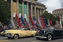 FILE — In this 2016 photo,  a parade of classic cars rolls down Constitution Avenue in honor of World War II veterans for the National Memorial Day Parade. (WTOP/Megan Cloherty, File)