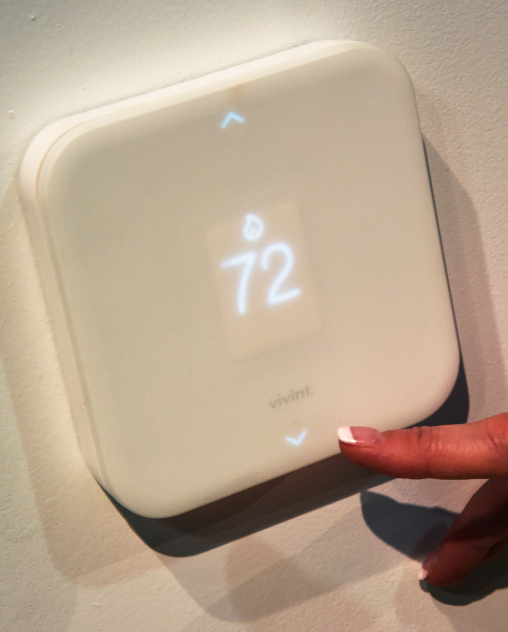 LAS VEGAS, NV - JANUARY 07:  The Vivint Element Thermostat is displayed at CES 2016 at the Sands Expo and Convention Center on January 7, 2016 in Las Vegas, Nevada. The Element, part of the Vivint Sky smart home system, senses if you're at home or away and if you're sleeping and adjusts the temperature according to your settings. IT can also be accessed from any mobile device. CES, the world's largest annual consumer technology trade show, runs through January 9 and features 3,600 exhibitors showing off their latest products and services to more than 150,000 attendees.  (Photo by Ethan Miller/Getty Images)