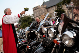 The Rev. James Magness blesses motorcycles during the 'Blessing of the Bikes' at the Washington National Cathedral, May 27, 2016, in Washington, DC. Rolling Thunder members and supporters will participate in a motorcycle rally on Sunday afternoon in Washington. Rolling Thunder is an advocacy group that seeks to bring awareness to prisoners of war (POWs) and missing in action (MIA) service members of all U.S. wars. (Photo by Drew Angerer/Getty Images)