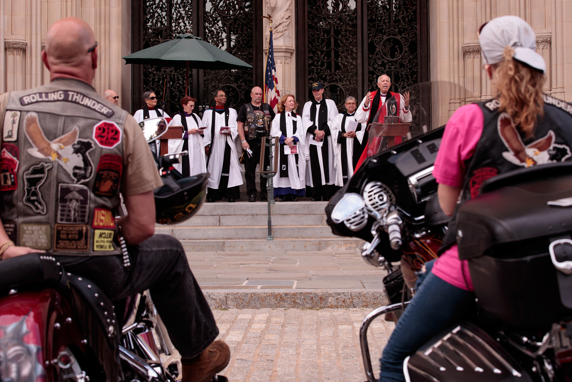 WASHINGTON, DC - MAY 27: Rolling Thunder members and supporters listen to opening remarks during the 'Blessing of the Bikes' at the Washington National Cathedral, May 27, 2016, in Washington, DC. Rolling Thunder members and supporters will participate in a motorcycle rally on Sunday afternoon in Washington. Rolling Thunder is an advocacy group that seeks to bring awareness to prisoners of war (POWs) and missing in action (MIA) service members of all U.S. wars. (Photo by Drew Angerer/Getty Images)