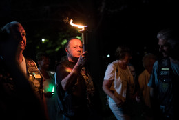 WASHINGTON, DC - MAY 27: Joe Bean, Vice President of Rolling Thunder, carries a torch near the Vietnam Veterans Memorial, May 27, 2016, in Washington, DC. Rolling Thunder members and supporters will participate in a motorcycle rally on Sunday afternoon in Washington. Rolling Thunder is an advocacy group that seeks to bring awareness to prisoners of war (POWs) and missing in action (MIA) service members of all U.S. wars. (Photo by Drew Angerer/Getty Images)