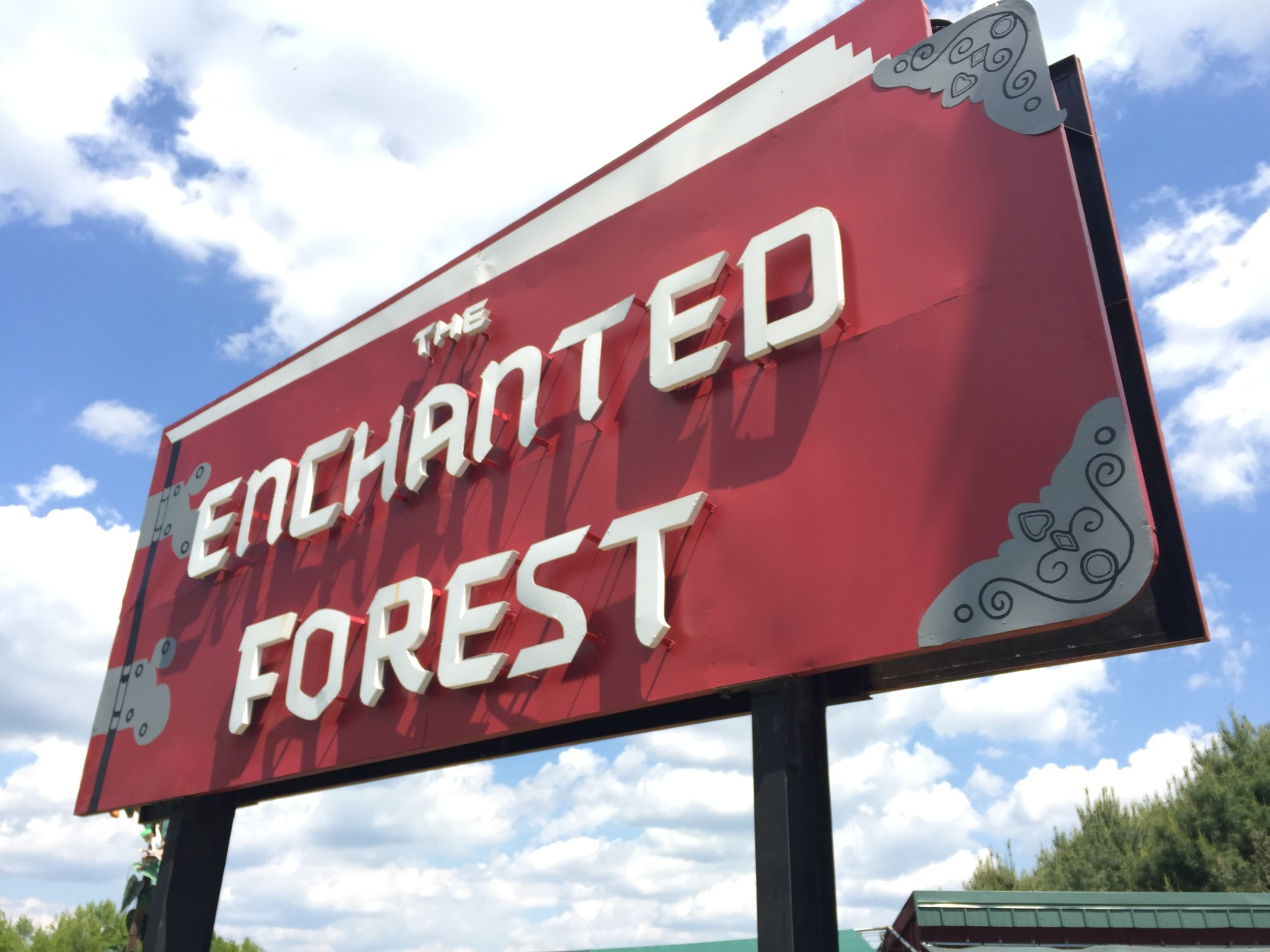 The metal Enchanted Forest sign was moved to Clark's Elioak Farm last summer, along with a white castle. Both used to greet visitors at the entrance to the long-closed amusement park. (WTOP/Michelle Basch)