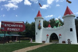 The sign and white entrance castle now sit next to each other at their new home. (WTOP/Michelle Basch)