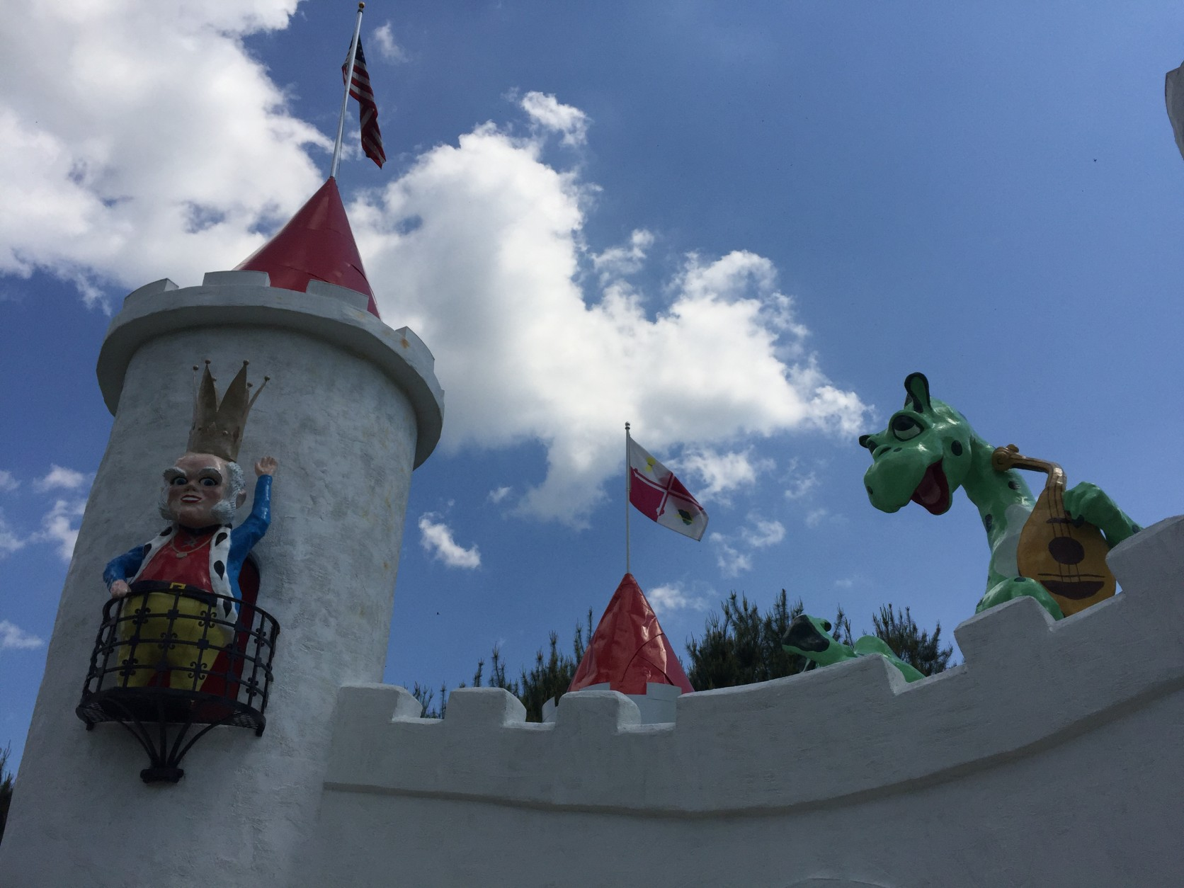 Ole King Cole and a dragon look down from the top of the castle. The king is a replica of the one that still stands atop a pole at the Enchanted Forest Shopping Center, which is the original site of the amusement park. (WTOP/Michelle Basch)