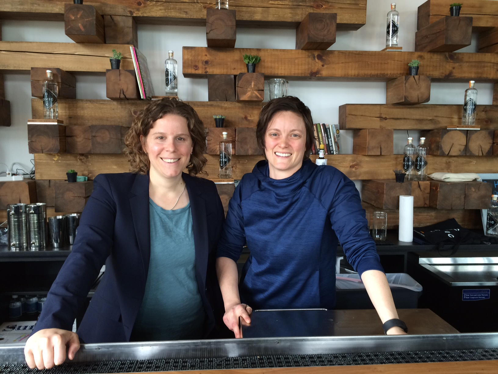 Pia Caursone, left, opened a bourbon distillery with her best friend Rachel Gardner, right, in May.  Carusone decided to pursue her dream of owning a distillery after the 2011 shooting of her boss, Gabby Giffords. (WTOP File Photo/Rachel Nania)