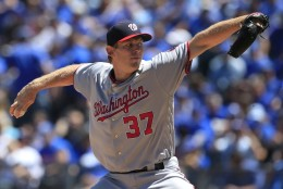 Washington Nationals starting pitcher Stephen Strasburg delivers to a Kansas City Royals batter during the first inning of a baseball game at Kauffman Stadium in Kansas City, Mo., Wednesday, May 4, 2016. (AP Photo/Orlin Wagner)