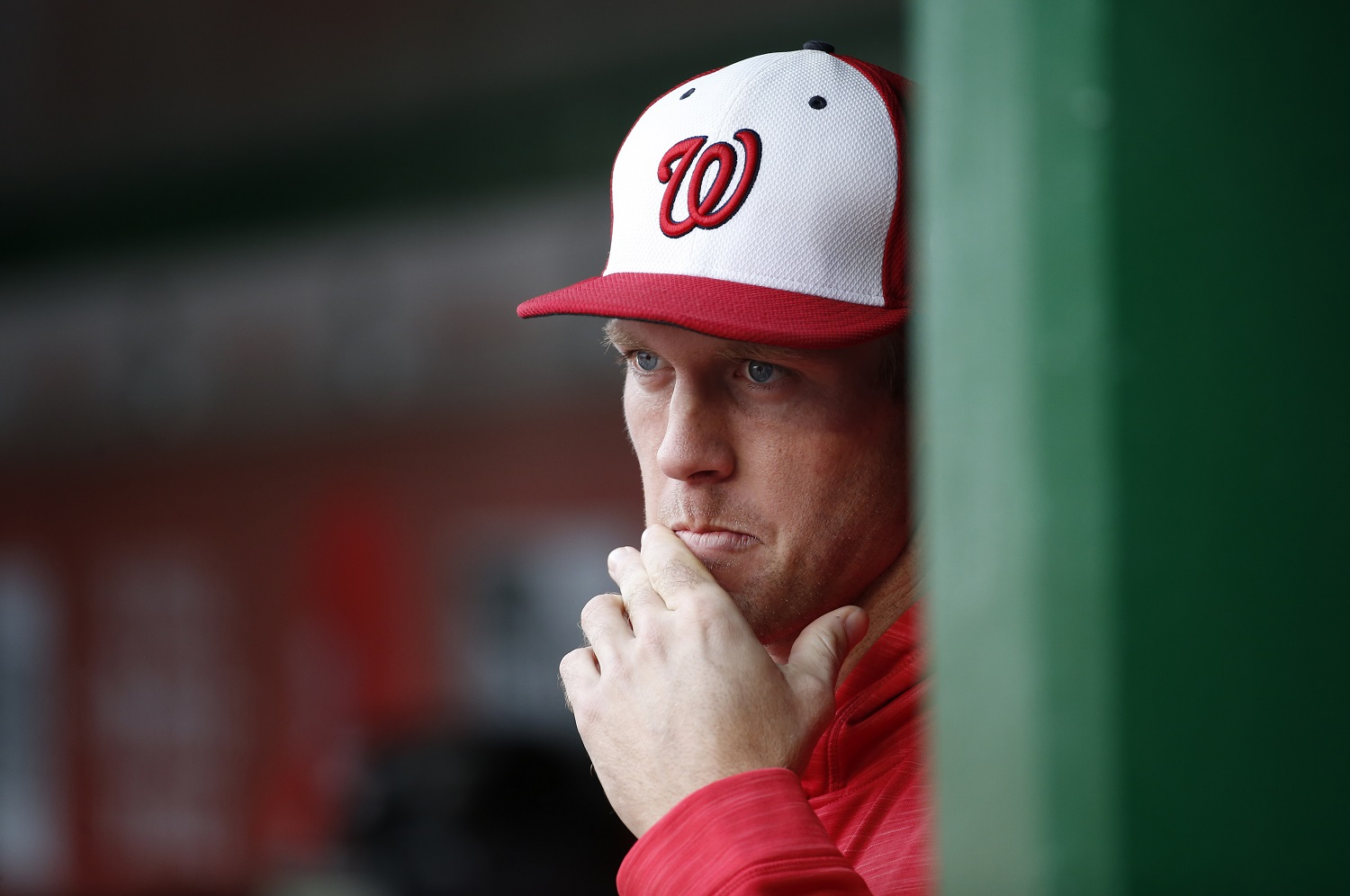 Washington Nationals starting pitcher Stephen Strasburg (37) pauses in the dugout during an exhibition baseball game against the Minnesota Twins at Nationals Park, Saturday, April 2, 2016, in Washington. The game ended in an 8-8 tie. (AP Photo/Alex Brandon)