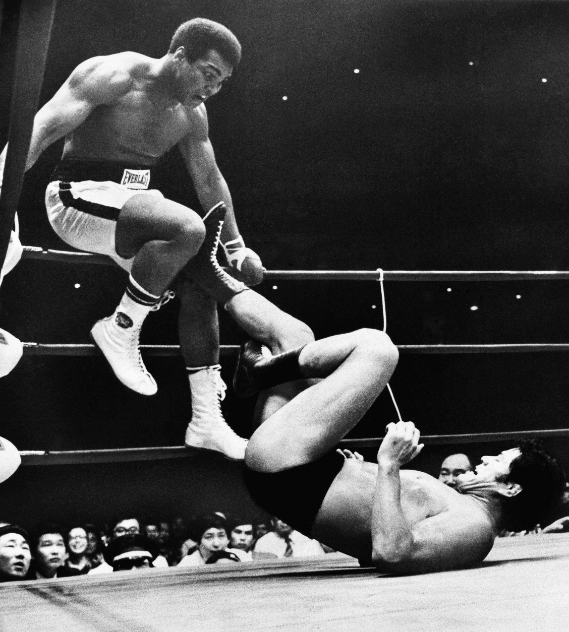 FILE - In this July 26, 1976, file photo, world heavyweight boxing champion Muhammad Ali is shown trying to evade kicks by wrestler Antonio Inoki during their 15-round World Martial Arts match, in Tokyo. The freak show Floyd Mayweather Jr. and Connor McGregor are talking about probably won't happen, though stranger things have happened. (AP Photo/File)