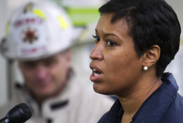 Washington Mayor Muriel Bowser briefs reporters after a CSX freight train derailed, spilling hazardous material, near a Metro station in Washington on Sunday, May 1, 2016. (AP Photo/Cliff Owen)