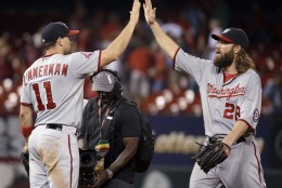 Washington Nationals' Ryan Zimmerman, left, and Jayson Werth celebrate following the Nationals' 4-3 victory over the St. Louis Cardinals in a baseball game Wednesday, Sept. 2, 2015, in St. Louis. (AP Photo/Jeff Roberson)