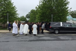 To celebrate Winffel's life, hundreds turned out for a burial Mass at the St. Rose of Lima Catholic Church in Gaithersburg. (WTOP/John Aaron)